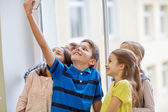 Group of school kids taking selfie with smartphone — Stock Photo