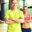 Smiling man and woman in gym — Stock Photo #60678289