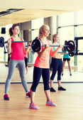 Group of women with barbells in gym — Stock Photo