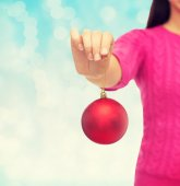 Close up of woman in sweater with christmas ball — Fotografia Stock