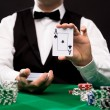 Holdem dealer with playing cards and casino chips — Stock Photo #60680901