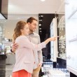Couple looking to shopping window at jewelry store — Stock Photo #60681151