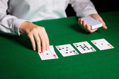 Holdem dealer with playing cards — Stock Photo