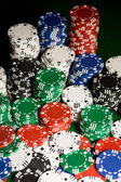 Close up of casino chips on green table surface — Stockfoto