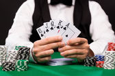 Poker player with cards and chips at casino — Fotografia Stock