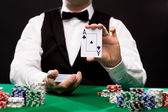 Holdem dealer with playing cards and casino chips — 图库照片
