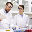 Young scientists making test or research in lab — Stock Video #60698497
