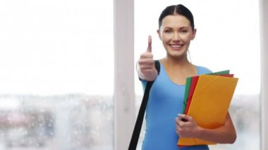 Student with bag and folders showing thumbs up — Video Stock