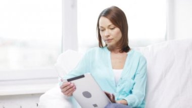 Calm woman with tablet pc computer at home — Stock Video