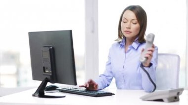 Busy businesswoman with telephone and computer — Stock Video