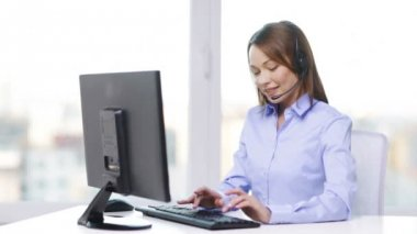 Female helpline operator with computer at office — Stock Video
