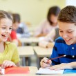 Group of school kids writing test in classroom — Stock Photo #60819115