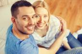 Smiling happy couple at home — Stock Photo