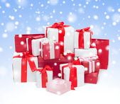 Christmas presents over blue background with snow — Stockfoto