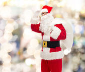 Man in costume of santa claus with bag — 图库照片