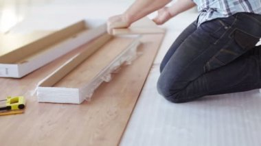 Close up of male hands measuring wood flooring — Stock Video