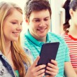 Smiling students with tablet pc at school — Stock Photo #60849517