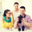 Smiling team with photocamera working in office — Stock Photo #60851181