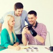 Smiling team with photocamera working in office — Stock Photo #60851215