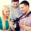 Smiling team with photocamera working in office — Stock Photo #60851245