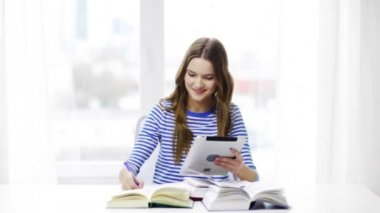 Smiling student girl with tablet pc and books — Αρχείο Βίντεο
