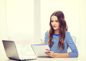 Teenage girl laptop computer and notebook — Stock Photo