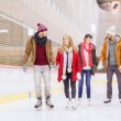 Happy friends on skating rink — Stock Photo #61595811