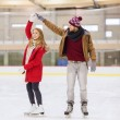 Happy couple holding hands on skating rink — Stock Photo #61595879