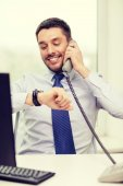 Smiling businessman making call — Stock Photo