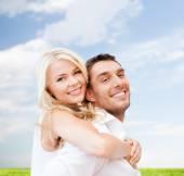 Happy couple having fun over poppy flowers field — Stock Photo