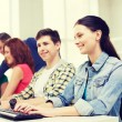 Group of smiling students having discussion — Stock Photo #61654749