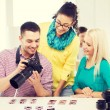 Smiling team with photocamera working in office — Stock Photo #61655379
