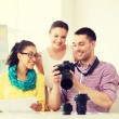 Smiling team with photocamera working in office — Stock Photo #61655427