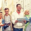 Group of friends with city guide, map and camera — Stock Photo #61655901