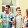 Group of smiling friends with take away coffee — Stock Photo #61656309