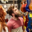 Couple of musicians with guitar at music store — Stock Photo #61819773