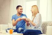 Man giving his girlfriend or wife cup of coffee — Stock Photo