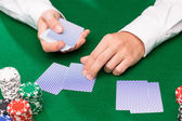 Holdem dealer with playing cards and casino chips — Foto de Stock