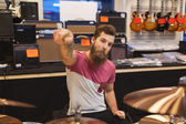 Male musician playing cymbals at music store — Foto de Stock