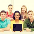 Smiling students showing tablet pc blank screen — Stock Photo #61893459