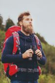 Man with backpack and binocular outdoors — Stock Photo