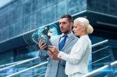 Businesspeople with tablet pc outdoors — Stock Photo