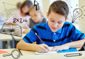 Group of school kids writing test in classroom — ストック写真