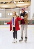 Happy couple on skating rink — Stock Photo