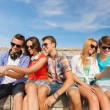 Group of smiling friends with tablet pc outdoors — Stock Photo #62111239