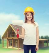 Smiling little girl in helmet with paint roller — Stock Photo