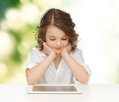 Happy smiling girl with tablet pc computer — Stockfoto