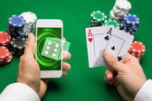 Casino player with cards, smartphone and chips — Stock Photo