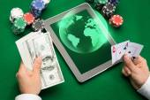 Casino poker player with cards, tablet and chips — Stock Photo