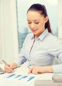 Businesswoman with phone, laptop and files — Stock Photo
